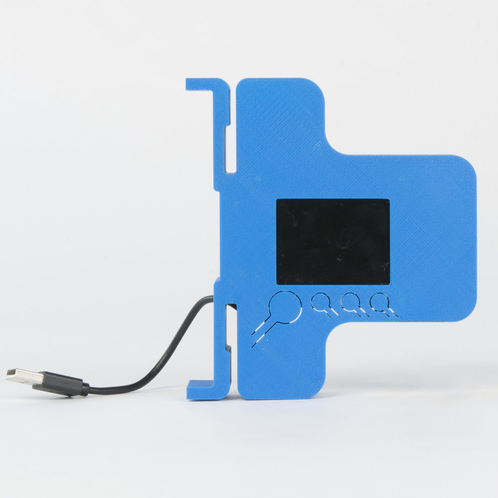 Camera with Battery Holder - Type B   This housing is made from a 3D printed shell and a lasercut acrylic rear panel, it features hooks and a ledge for attaching a USB battery with cable ties or elastic bands. On this version, the Pi end of the USB power cable is captive inside the housing..  more