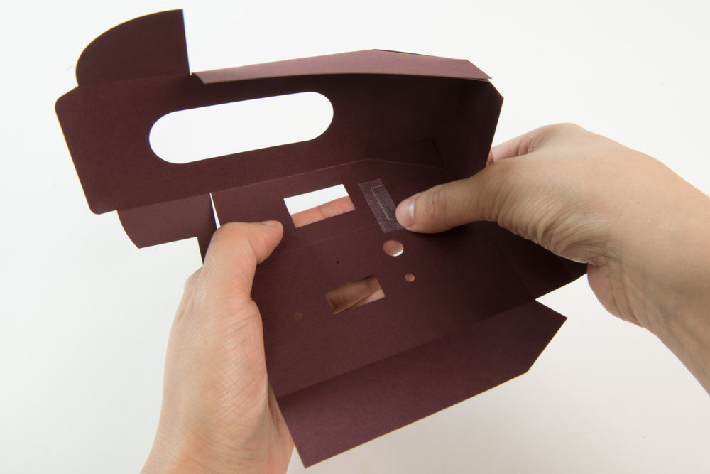 Step 25  Tape down the edge of this tab fully to allow the inner case to smoothly slide inside the outer case.