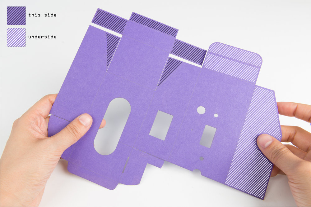 Step 14  Apply double-sided tape or glue to all the tabs on the cut card of the outer case