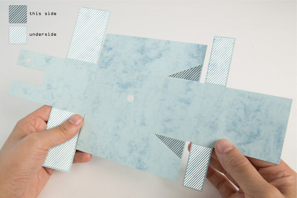 Step 27  Apply double-sided tape or glue to all the tabs on the cut card of the inner case.