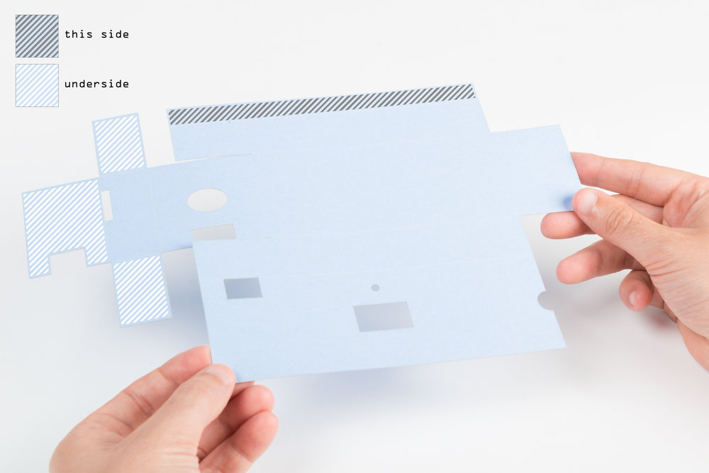 Step 13  Apply double-sided tape or glue to all the tabs on the cut card of the inner case.