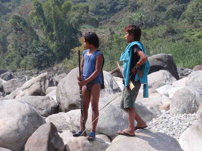 """Two young hunters watching us portage the rafts over boulders"" (Pic credit: Janaki Lenin)"