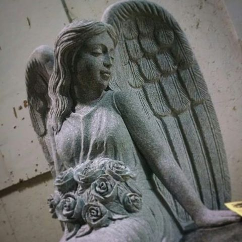 Angel bench carved from one solid stone #angel #bench #monument #granite #cochransinc
