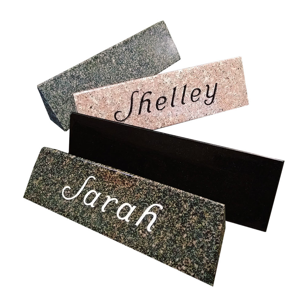 Desk plaques can be sandblasted on any color of stone, Laser etching can only be done on the black granite.