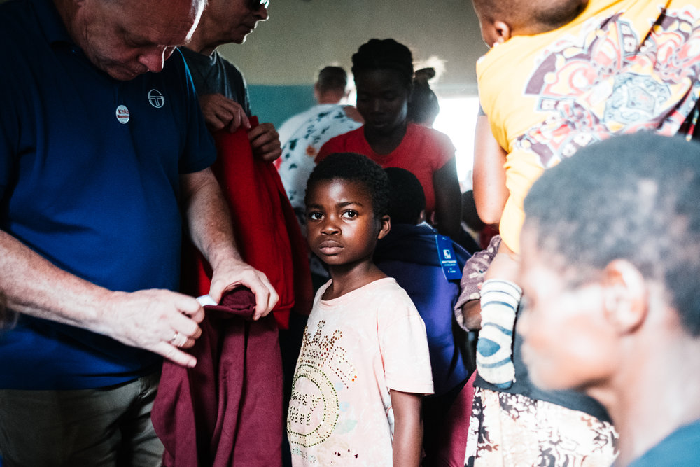 A child waiting to be given a new piece of clothing at the Chole centre