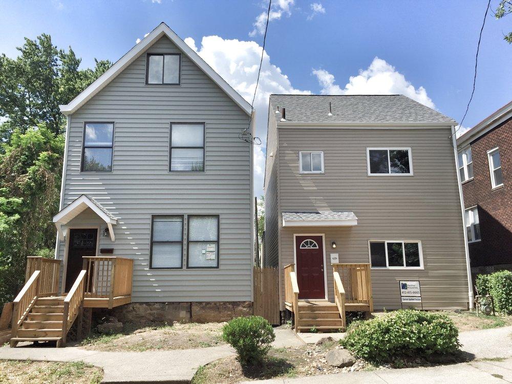 Side by side  rental  homes rebuilt after fire.