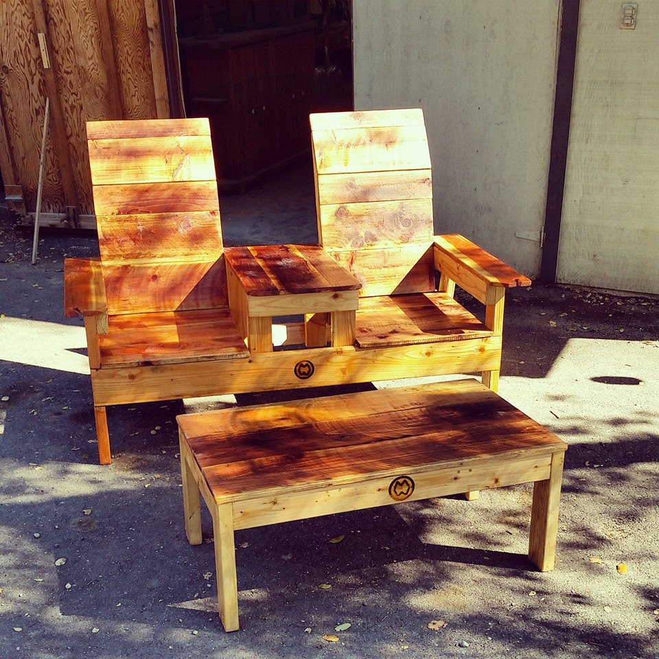 Matching love seat with coffee table patio set with wine glass holder.