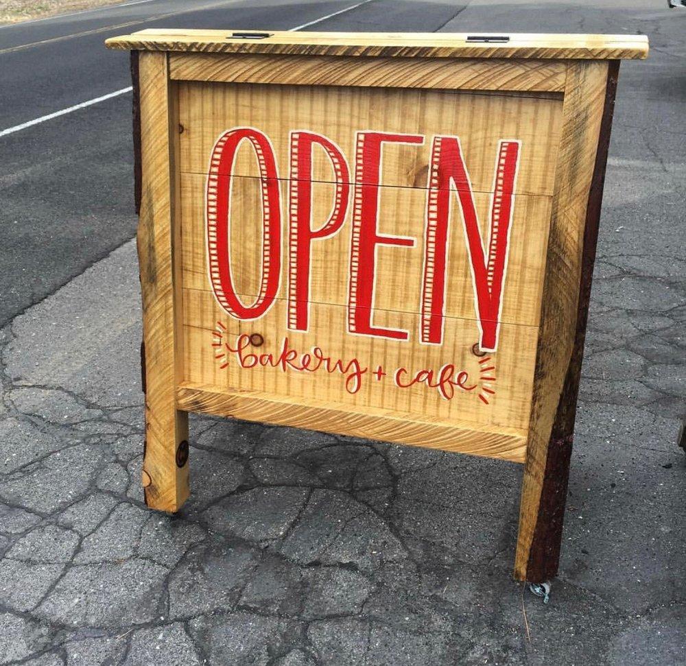 Outside Open sign for Alicia's Sugar Shack in Sugar Pine, CA