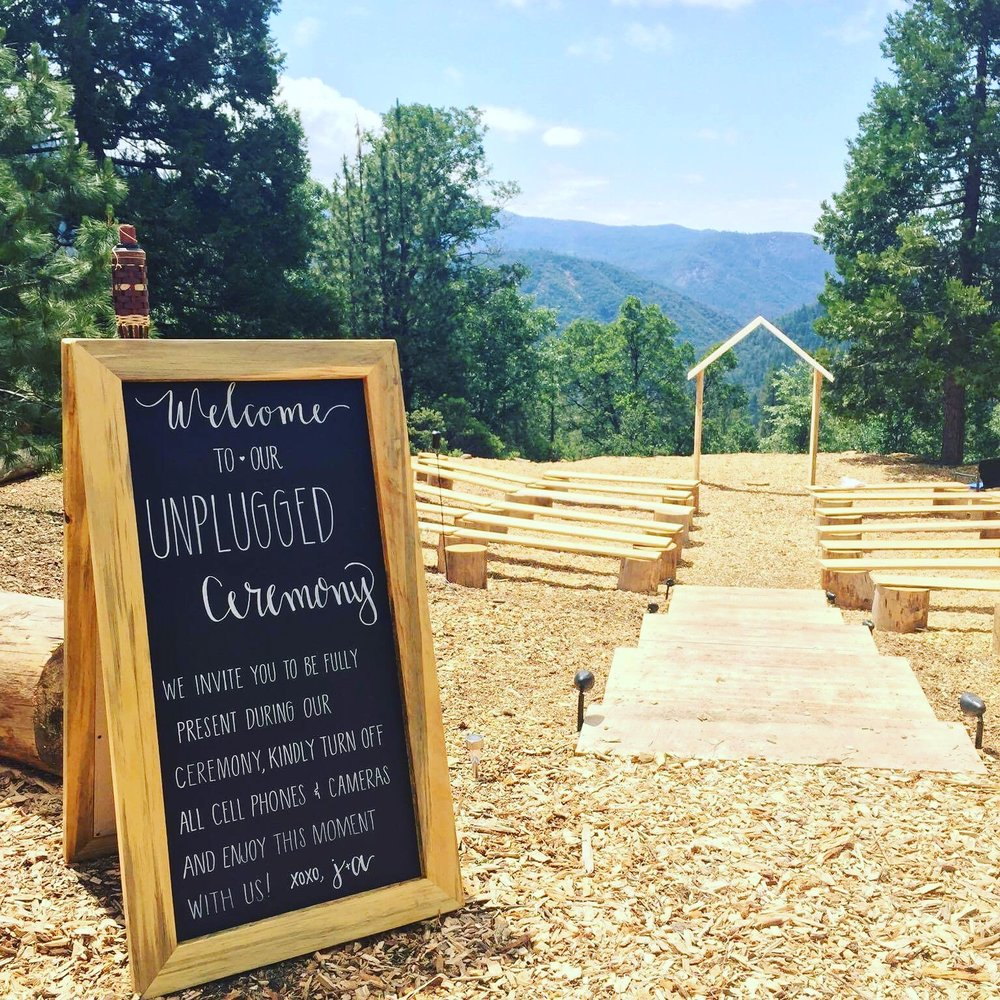 Sugar pine chalk board sign being used for a wedding.
