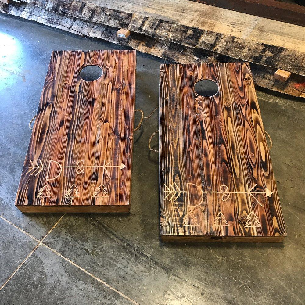 Custom engraved corn hole boards.