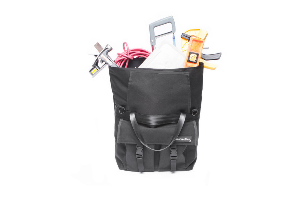 Rolltoptotebag with construction accessories.jpg