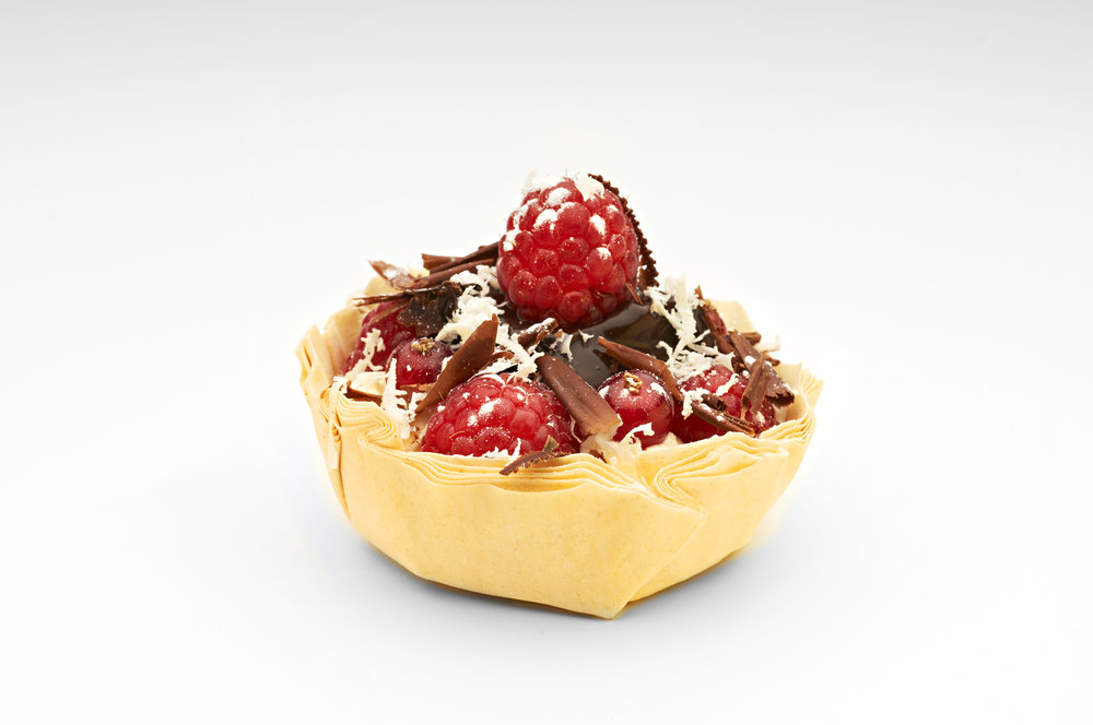 "Lemon  crème topped with b lack cherries, raspberries and dark chocolate in a  3"" Filocrown .  Product code - FF3030"