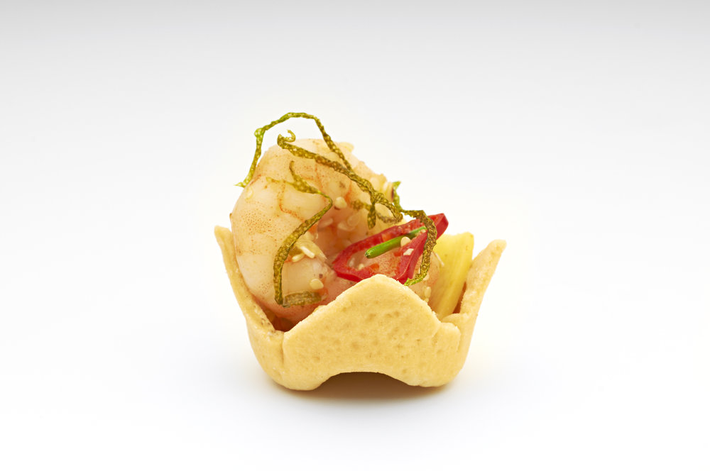 "Cold water Atlantic prawns and lime ginger with a dash of red chilli oil in a 1"" Cheese Straw Crown. Product code - FF2015"