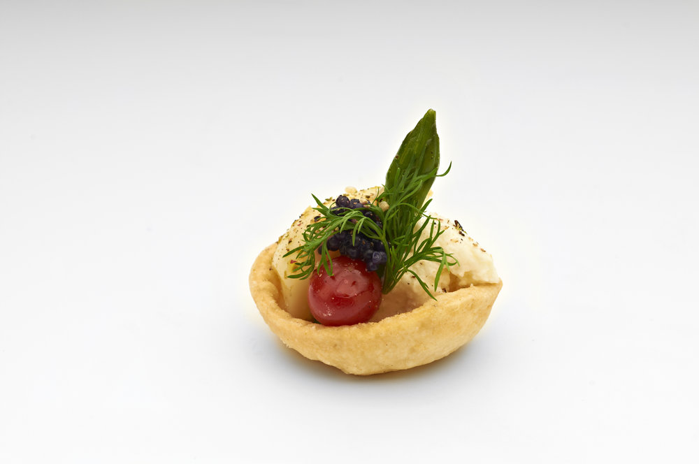 "Poached asparagus and quails egg together in a 1"" cheese straw basket finished with toasted sesame seeds. Product code - FF2011"