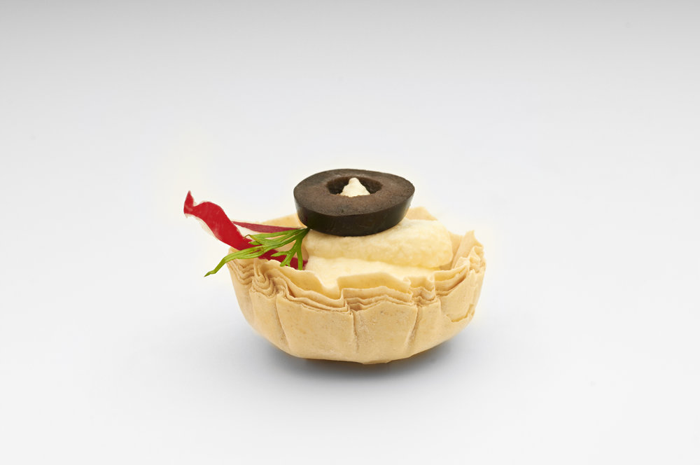 "Creamed hummus and roast red chilli brought together in a  1"" filo case   Product code - FF3010"