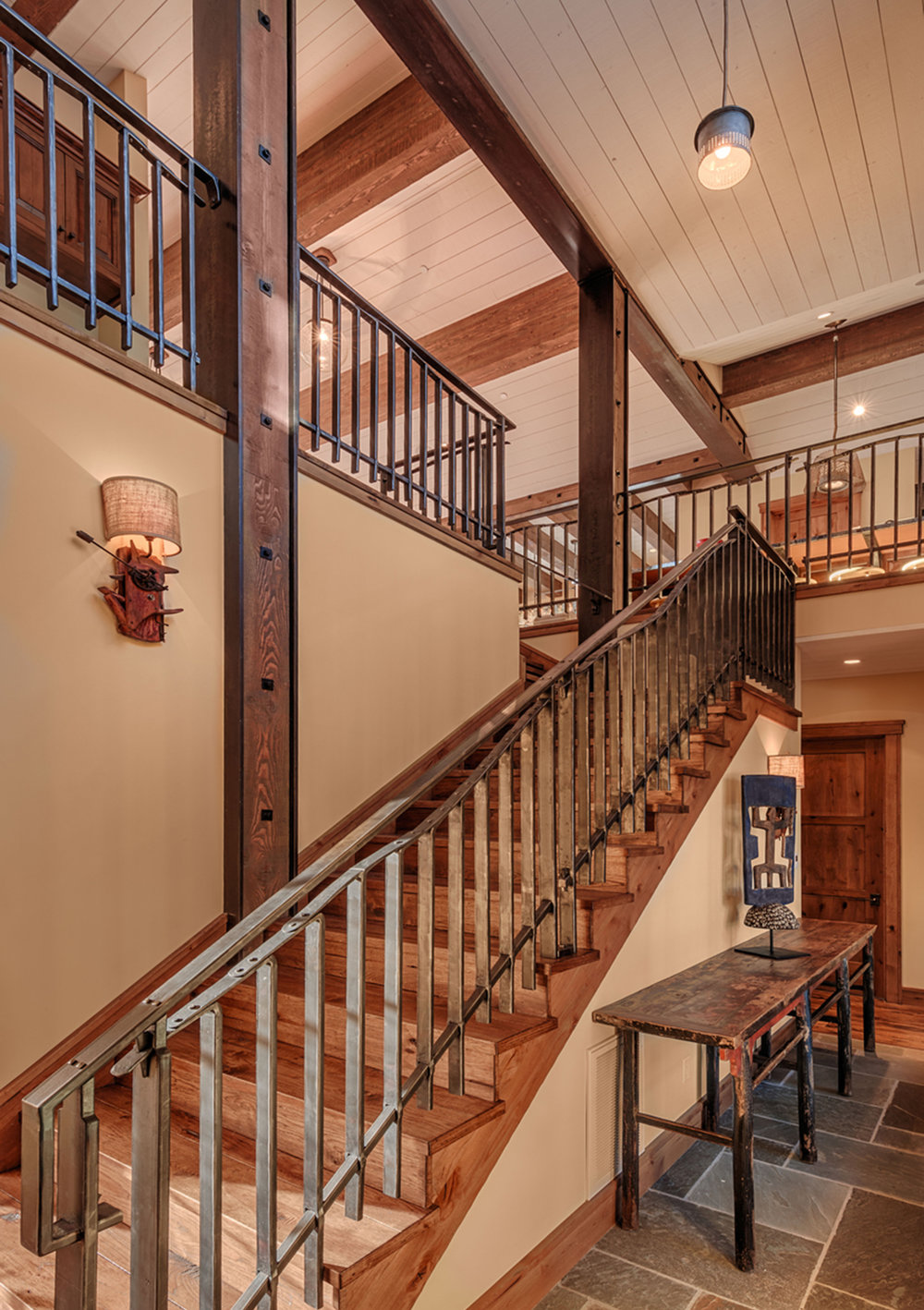 Lot 280_Staircase_Wood Ceiling_Wood Beams_Decorative Metal Handrail.jpg