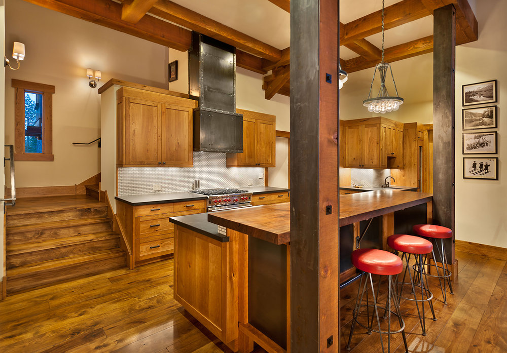 Lot 283_Kitchen_Island_Metal Detail on Wood Beams_Metal Wall Hood.jpg