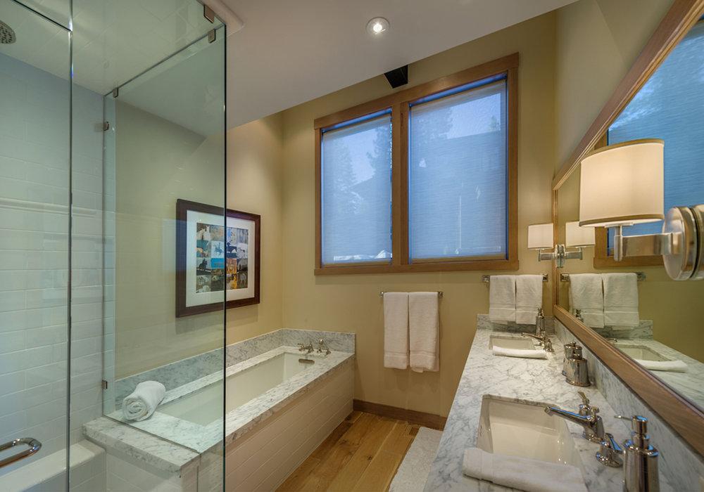 Lot 292_Guest Bath_Shower Enclosure_builtin tub_Slab vanity.jpg
