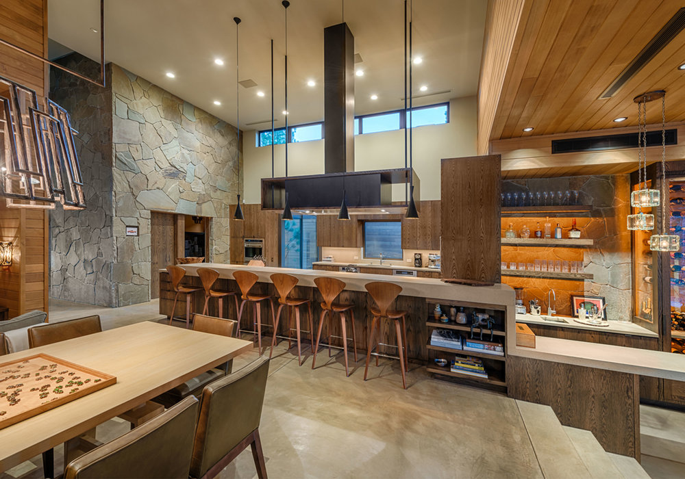 Lot 403_Kitchen_Island_Waterfall Slab_Concrete Floors.jpg