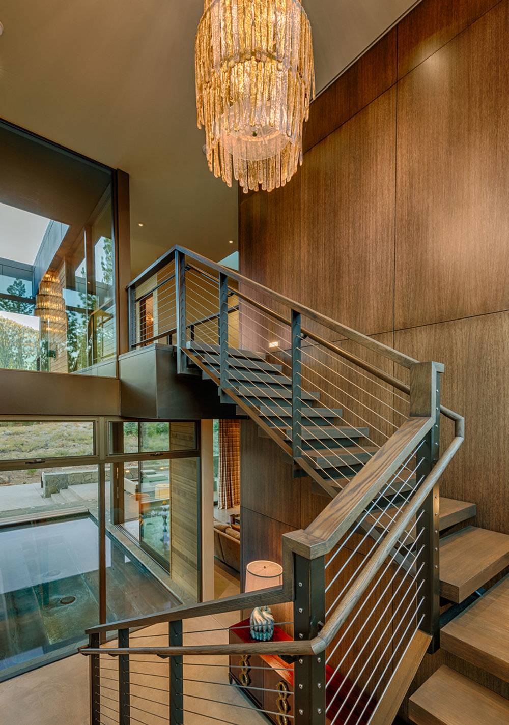 Lot 403_Staircase_Metal Railing_Wood Panel Walls_Chandelier.jpg