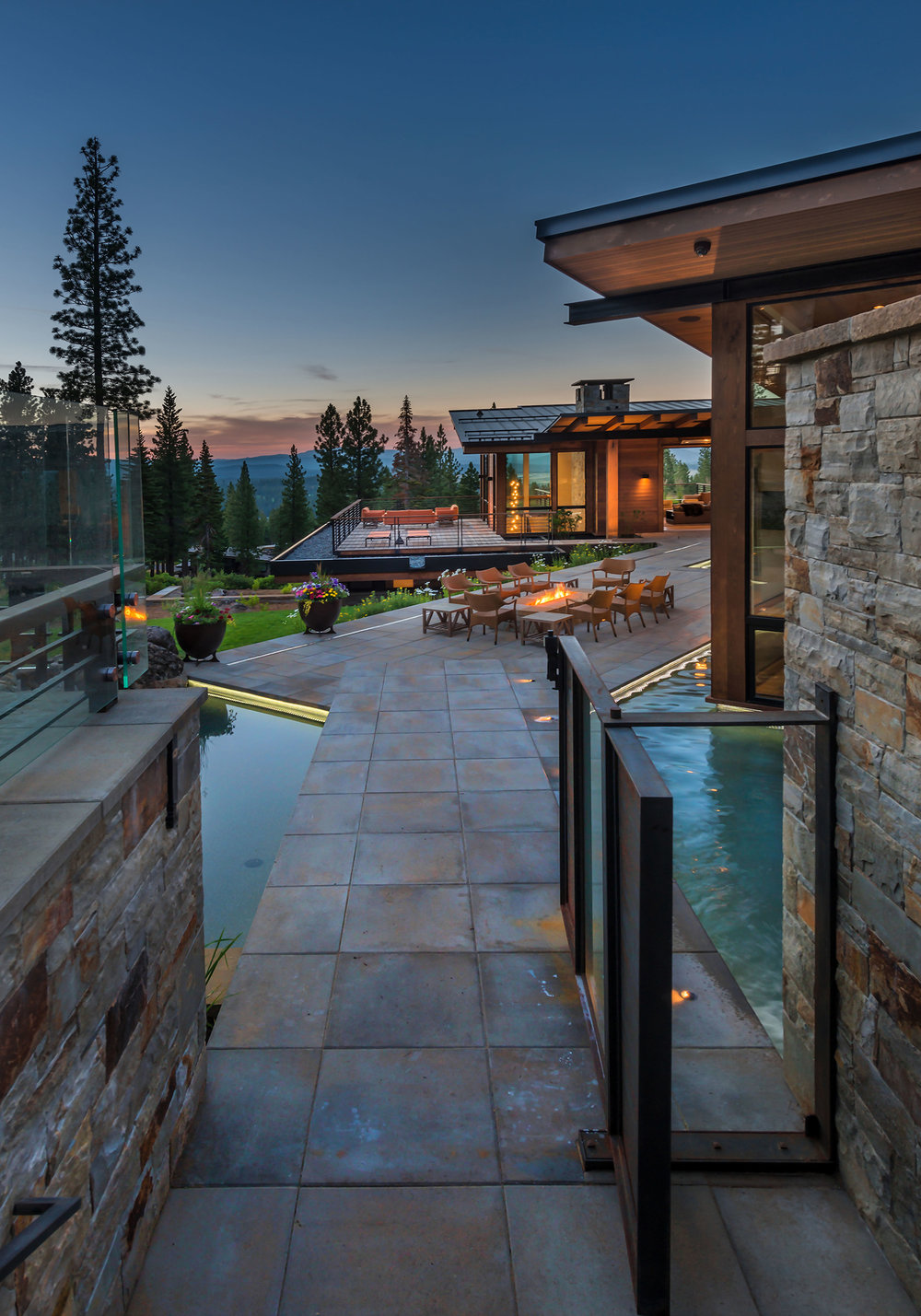 Lot 595_Exterior_Water Features_Glass Gate_Firepit_Landscaping_View.jpg