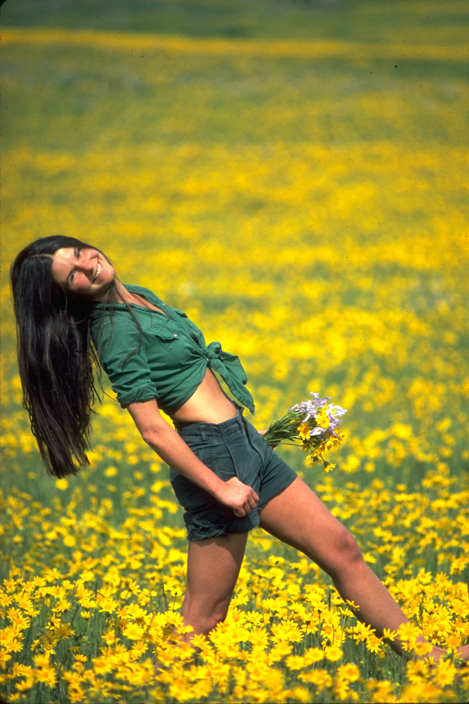 Girl in a field of wildflowers