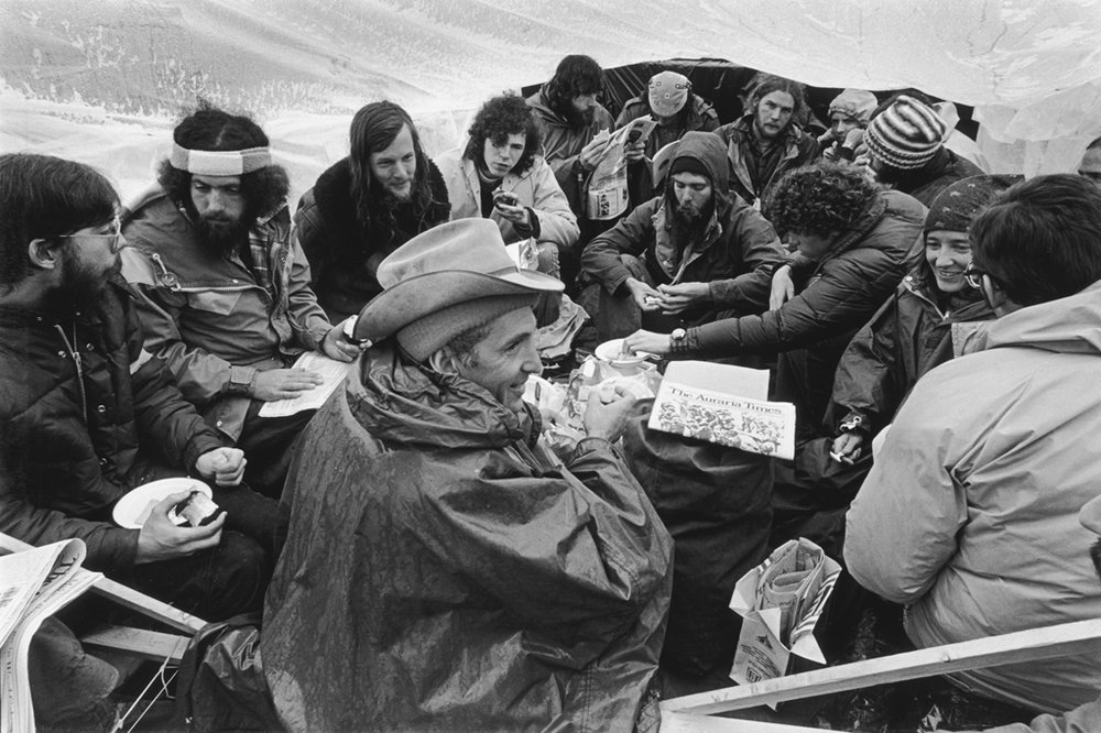 The protest has attracted several celebrities, including political activist Daniel Ellsberg (center) who shares a meal with other protesters in the main tent on the tracks, and seeks shelter from the worsening weather.