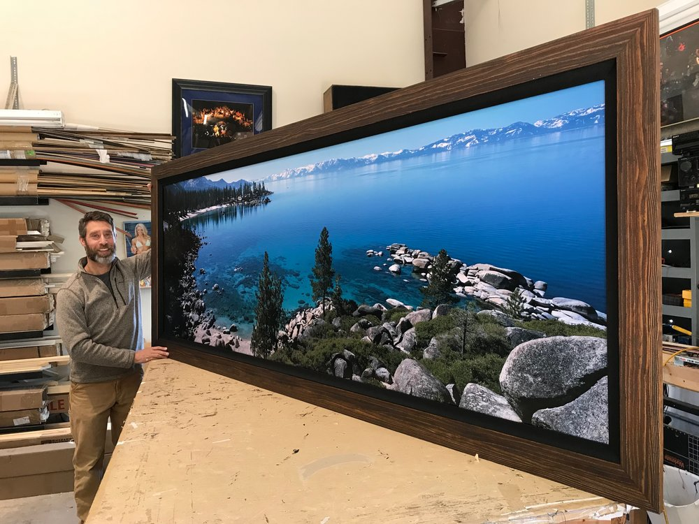 Jon Paul with an 8ft print produced from a scan on his Imacon / Hasselblad virtual drum scanner.
