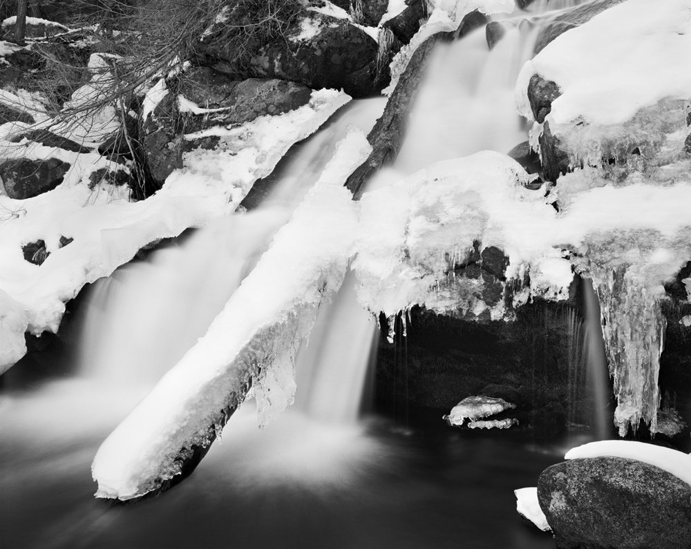 A long exposure (2 minutes) brings a soft ethereal feel ti this winter scene, contrasting against the jagged ice and granite.