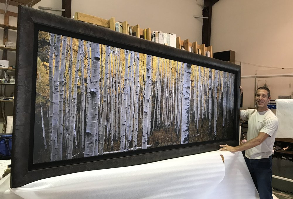 Jon Paul with a huge panorama framed and ready to ship to a new collector! Bringing his emotional experiences in nature to life with big film, and sharing them with the world, is what Jon Paul does.