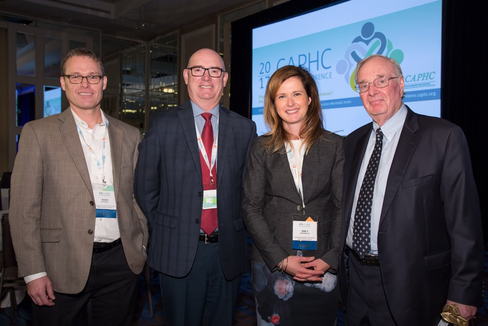 Doug Maynard (Associate Director, CAPHC), Dr. Peter Fitzgerald (CAPHC Board Chair), Emily Gruenwoldt (President & CEO, CAPHC), The Right Honourable Paul Martin. Photo: Dufour/Egan