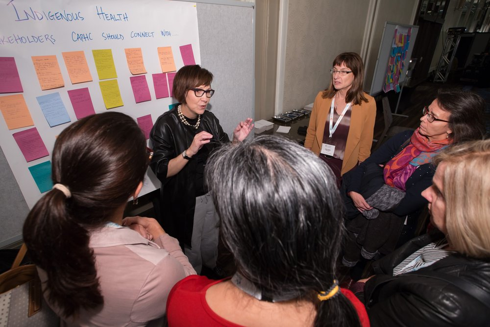 Dr. Cindy Blackstock chatting with delegates after her presentation. Photo: Dufour/Egan