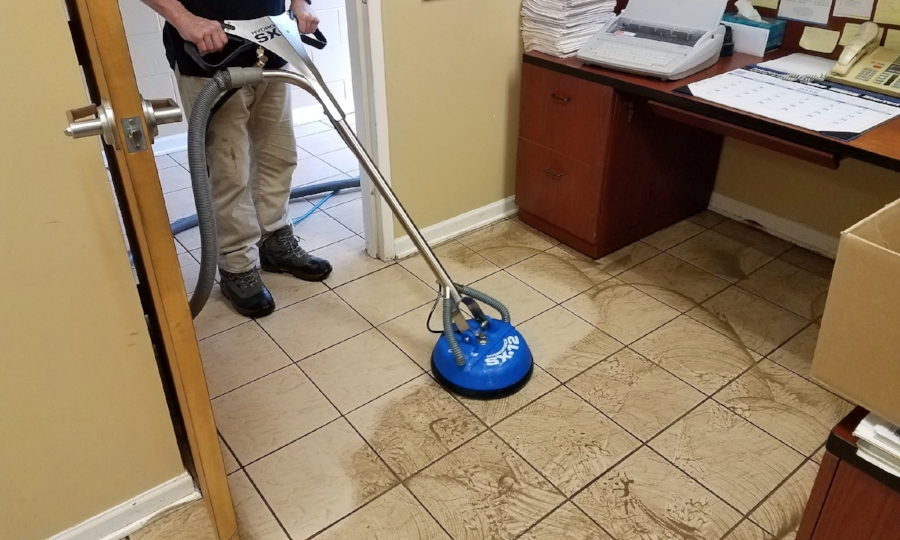 10 years of industrial gunk from a machine shop removed with our commercial tile cleaning process.