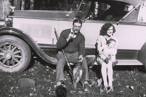 Showboat_and_his_wife_Flo_with_George_Jr_on_the_running_board_of_their_car.jpg