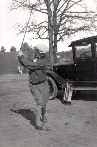 Warming_up_for_a_round_of_golf__Showboat_displaying_his_golf_togs__car_and_terrific_golf_swing.jpg