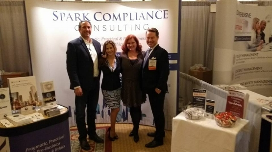 Spark Compliance's Ramsey Kazem, Diana Trevley, Kristy Grant-Hart and Jonathan Grant-Hart at the exhibition space, Compliance and Ethics Institute, Las Vegas, 2017.