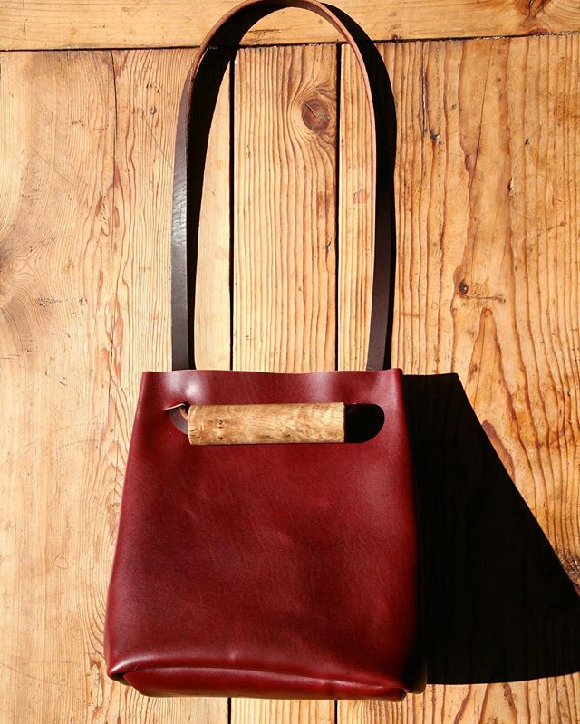 Bet you can't wait to get your hands on your very own Five/Eighteen. Our original bag in red with a maple burl bead.