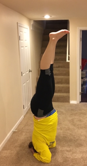 Eff yeah, that's a HEADSTAND! MY headstand! My feet are in the air, and my head is on the ground, woohoo!