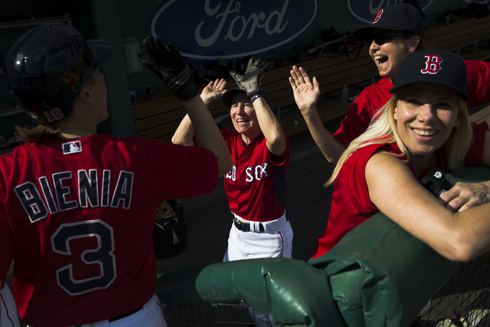 Members of the Comets baseball team are all smiles as they congratulate teammate Lisa Bienia (3) after she crossed home plate to score a run against the Belles during the second annual Women's Fantasy Baseball Camp at JetBlue Park Thursday, Jan. 12, 2017 in Fort Myers, Fla. After a day of training and drills the roughly 40 women are drafted and separated into four teams by former Boston Red Sox players and coaches. The teams then play a short tournament over the course of the four-day camp.