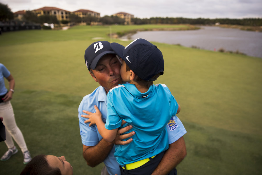 PGA Tour Pro Matt Kuchar receives a kiss from his son Carson Kuchar, 7, after winning the Franklin Templeton Shootout with teammate Harris English, not pictured, at Tiburón Golf Club at The Ritz-Carlton Golf Resort Saturday, Dec. 10, 2016 in Naples, Fla. The duo finished with a score of 28-under par.