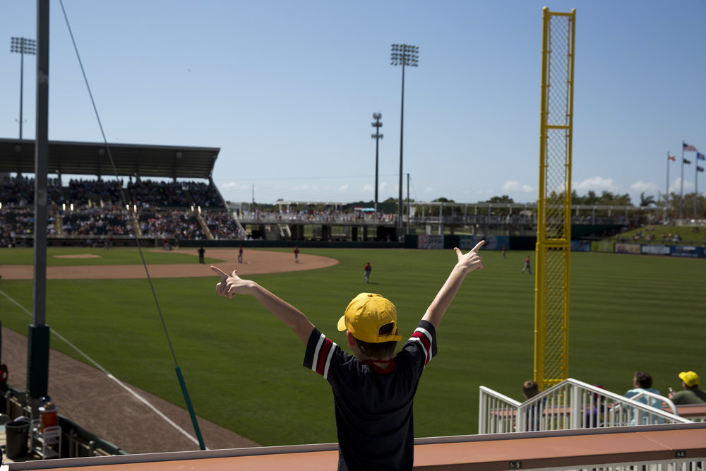 Twins fan Theo Bubser, 9, reacts to a Minnesota hit during a spring training game against the Boston Red Sox at Hammond Stadium in Fort Myers Thursday, March 31, 2016. The Twins would win 7-4 in their last home spring training game.