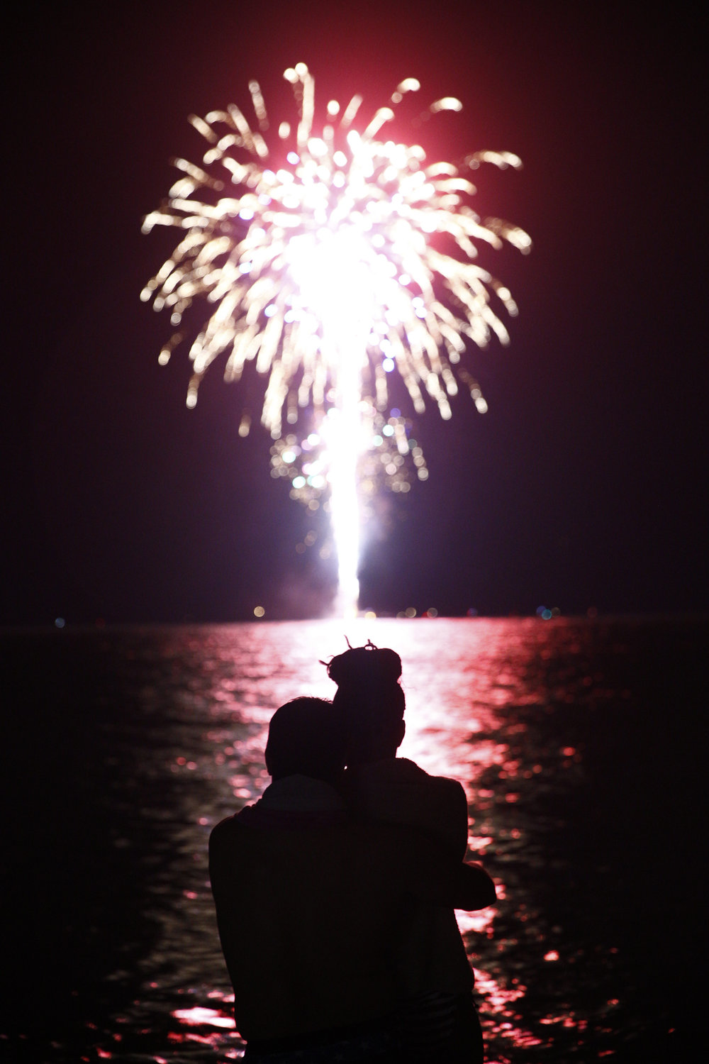 "Luis Lorenzo and his wife Aloima, both of Naples, embrace as they watch the fireworks off of Naples Beach Monday, July 4, 2016. This will be a day the couple will soon not forget. Originally from Cuba, Luis gained his United States citizenship February 26, 2016. ""For me this a great experience,"" Luis said. ""We're here baby!"""
