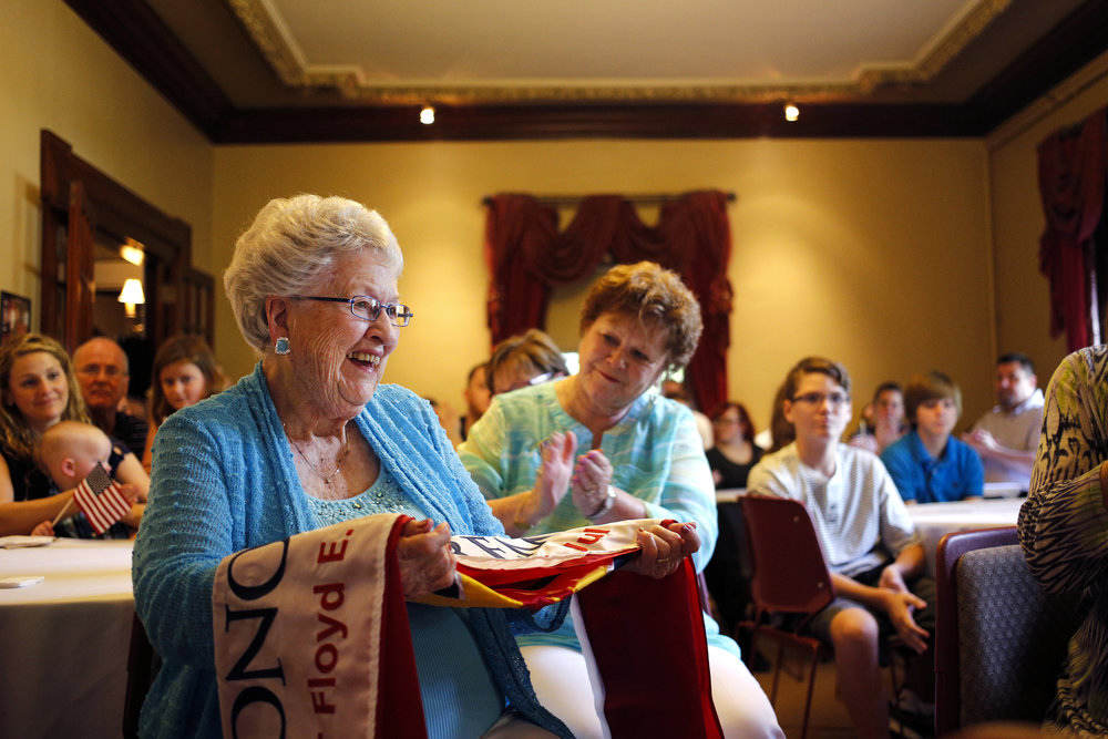 Mabel Stansbury, sister of the late Staff Sgt. Floyd E. Whittaker, is presented with an Honor and Remember Flag by the Honor and Remember Nebraska Chapter to commemorate Whittaker's sacrifice in the battle of St. Lo during World War II Sunday September 6, 2015 at the Ferguson House in Lincoln, Nebraska.