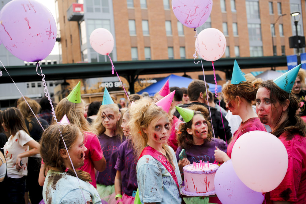 Makayla Schade, 13, (center) celebrates her birthday zombie style with friends and family Saturday August 29, 2015 during the 8th annual Zombie Walk in downtown Lincoln, Nebraska.