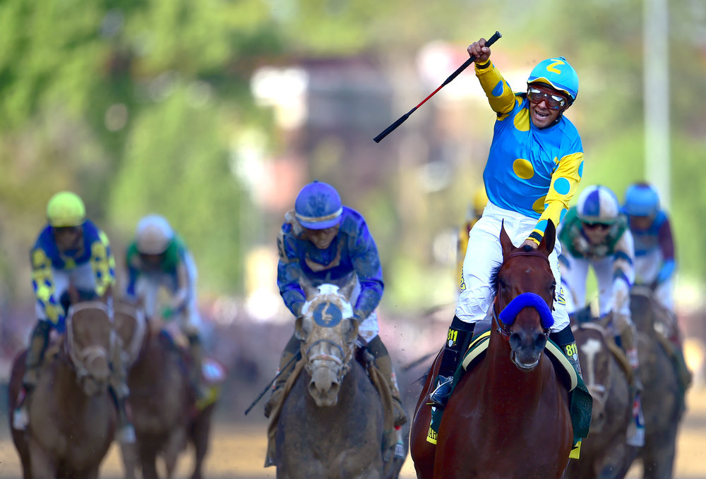 Jockey Victor Espinoza celebrates after crossing the finish line first aboard American Pharoah during the 141st running of the Kentucky Derby May 2, 2015 at Churchill Downs in Louisville, Ky. It would mark the second straight year Espinoza has won the the biggest horse race in North America after winning last year riding California Chrome. American Pharoah would go on to claim his spot in thoroughbred racing history after winning the next two legs of the historic Triple Crown, the Preakness and the Belmont. The fist time in 32 years.