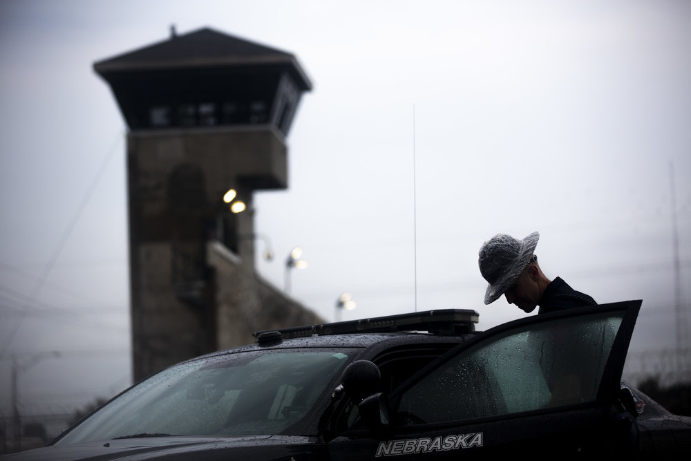 A Nebraska State Correctional Officer outside of the Nebraska State Penitentiary on the morning of Carey Dean Moore's planned execution via lethal injection Tuesday, Aug. 14, 2018 in Lincoln, NE.