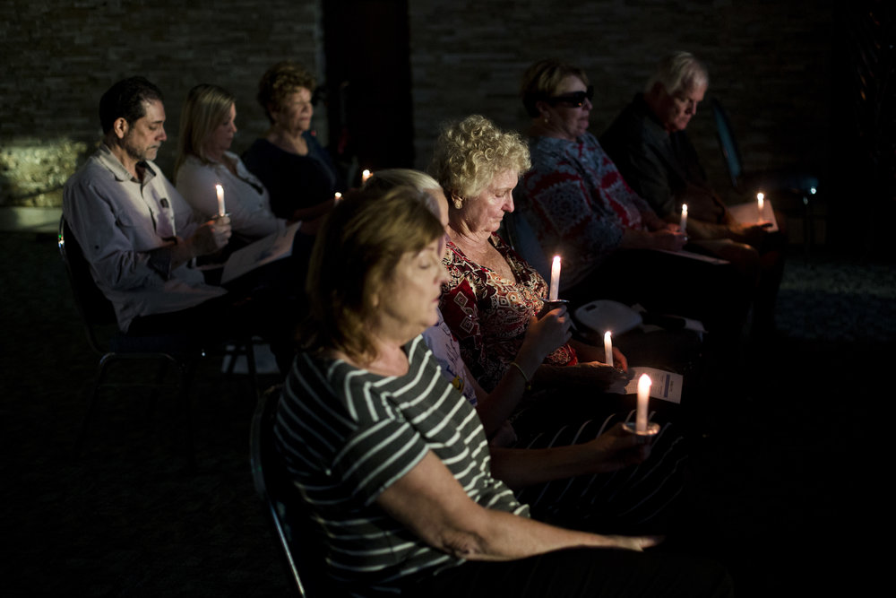 Lit candles signify lost loved ones as guests honor those close to them in a celebration of life and love during a Remembering memorial service at the Ispiri Community Center on the Avow Hospice campus Monday, April 24, 2017 in Naples.