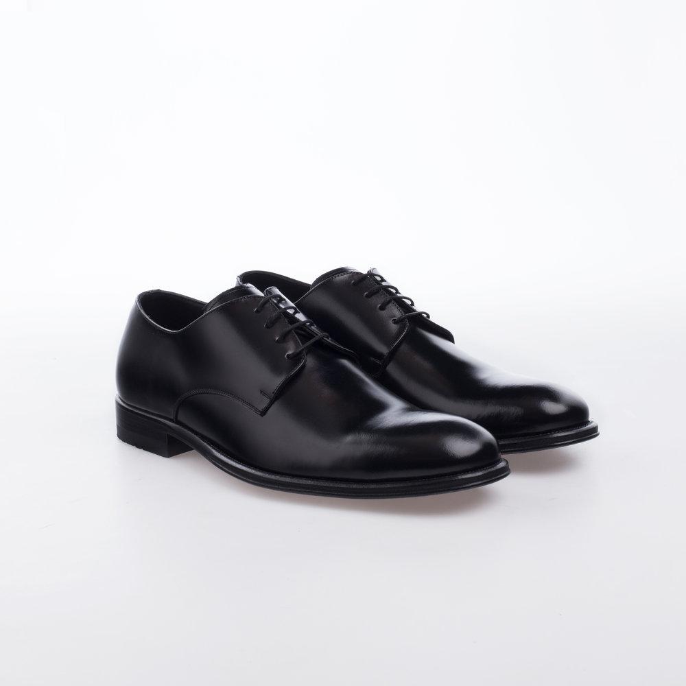 9140 Negro $1,299 MX Zapato Ingles liso .