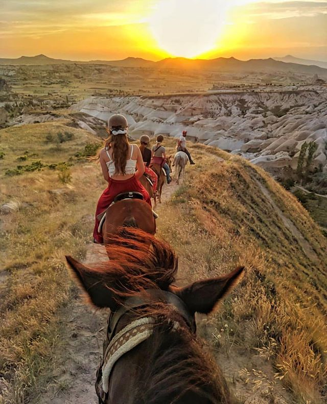 Inspiring horse ride by @thedishstance . Every girl dreams of riding off into the sunset, am I right? Thanks @daltonbrothersranch Cappadocia for such a beautiful evening 🐎🌄 Real talk, this was my first horse ride and I didn't find it difficult at all. If you visit Cappadocia, I highly recommend the sunset ride as it is one of the best ways to really get down into the canyons and see places up close that you otherwise might not be able to.  #cappadocia #TRVLR. . . . . . . #iamdigitalnomad #theglobalgirls #femmetravel #amazingtravelbeauty #speechlessplaces #ladiesgoneglobal #darlingescapes #prettylittletrips #traveldreamseekers #girlsaroundtheworld #citizenfemme #sunsetaddict #travelerslife #instaturkey #fradonointurkey #fradonoincappadocia #instacappadocia #turkeystagram #turkeyphotooftheday #horseriding #visitturkey #exploretheworld  #inspiringwanderers #worldnomads #keepexploring #lifewelltravelled . . . AmazingTravelBeauty✦ ✪ A M A Z I N G T R A V E L B E A U T Y -  BY @thedishstance ✪ #ATB_thedishstance ✪ Selected by @travel.birdy_global ✦ C O N G R A T U L A T I O N S 🏆 ✦ Date: 20. 06. 18 ✦  Tag your best shots to ☛ #AmazingTravelBeauty ✦ ☛ Stop by the artist's feed for more wonderful pics. ֹ Enjoy more beautiful photos by visiting our friends's pages. ☛ @michaeldockhamphoto ☛ @tangotraci ☛ @travel.birdy_global ☛ @flyfreewildbyrd ☛ @abbyventure ☛ @geek_grl ☛ @beyondphotography_with_ash ☛ @betsyarmour ☛ @socialmediamax  meet our whole team at: https://www.amazingtravelbeauty.com/about/