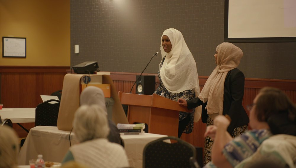 Ilays Aden & Fathia Absie speak at Eat With Muslims Anniversary dinner April 27, 2018
